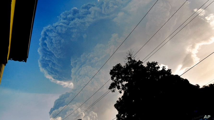 Ash rises into the air as La Soufriere volcano erupts on the eastern Caribbean island of St. Vincent, Tuesday, April 13, 2021. …