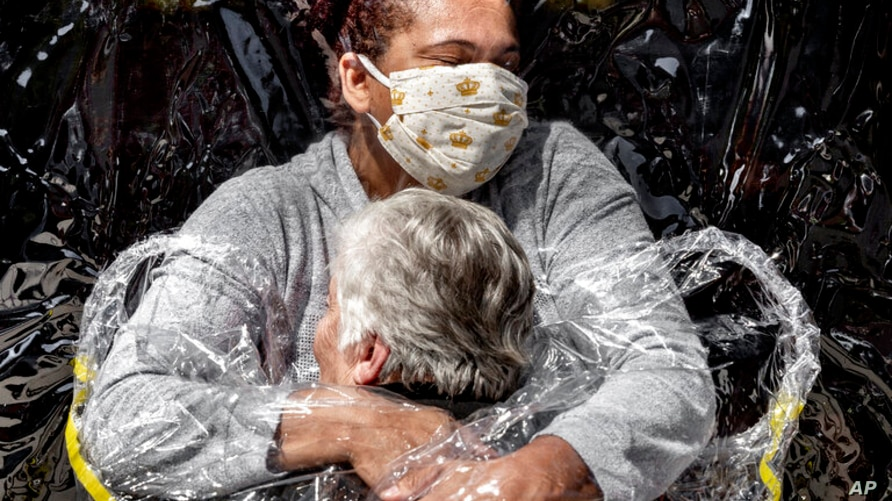 In this image released by World Press Photo, Thursday April 15, 2021, by Mads Nissen, Politiken, Panos Pictures, which won the…