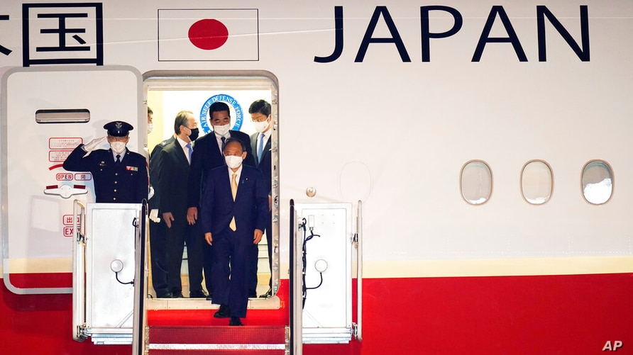 Japanese Prime Minister Yoshihide Suga arrives at Andrews Air Force Base, Md., Thursday, April 15, 2021. Suga will be the first…
