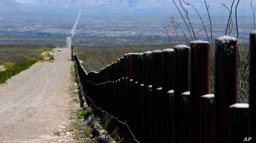FILE - In this March 18, 2016, file photo, a U.S. Customs and Border Patrol truck patrols the U.S. border with Mexico in…