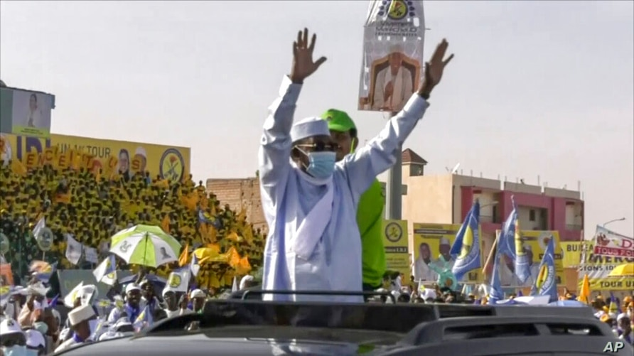 In this Friday, April 9, 2021 image made from video, Chadian President Idriss Deby Itno, center, attends his final campaign…