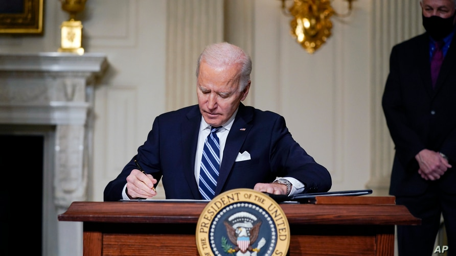 FILE - In this Jan. 27, 2021 photo, President Joe Biden signs an executive order on climate change, at the White House.