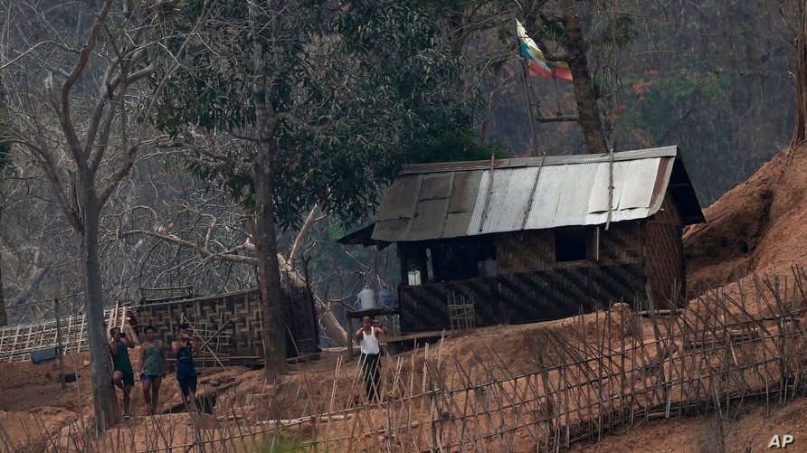 FILE - In this March 30, 2021, file photo, Myanmar soldiers stand at a small army camp