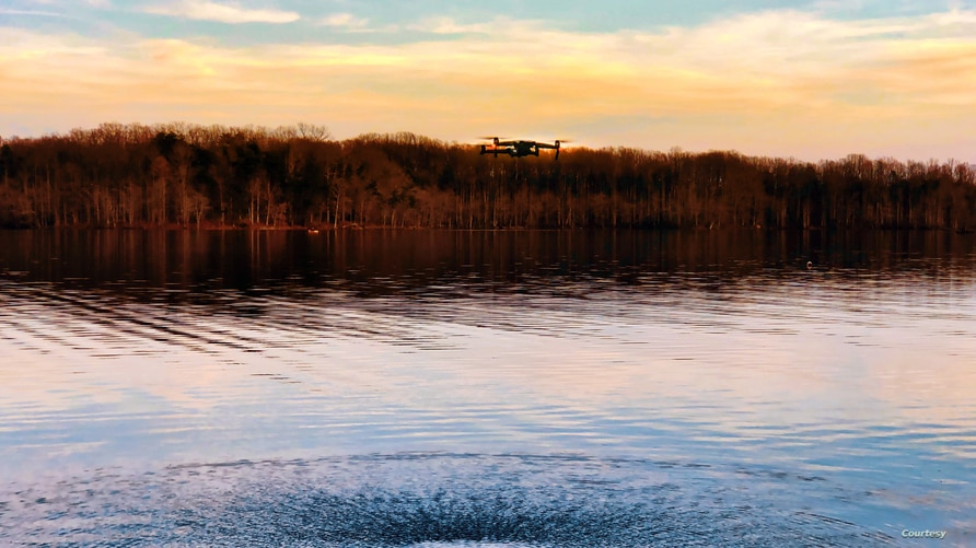 A DJI Mavic Air 2 drone hovers over water at Burke Lake, Virginia. (Photo: Diaa Bekheet)