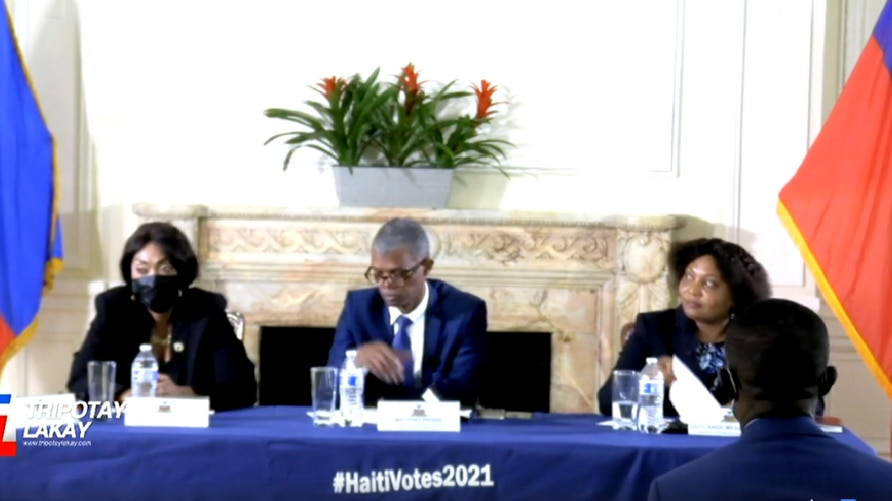 Haitian election officials Esperancia Cesar, left, Mathias Pierre, center and Guylande Mesadieu listen to diaspora questions