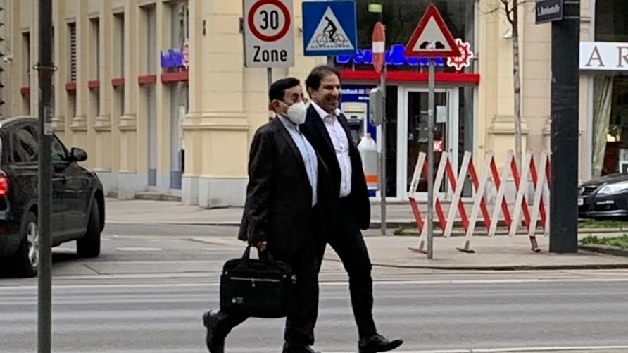 Two unidentified members of an Iranian delegation walk in Vienna on April 5, 2021 as they prepare for talks the next day aimed at reviving the 2015 Iran nuclear deal. (VOA Persian/Guita Aryan)