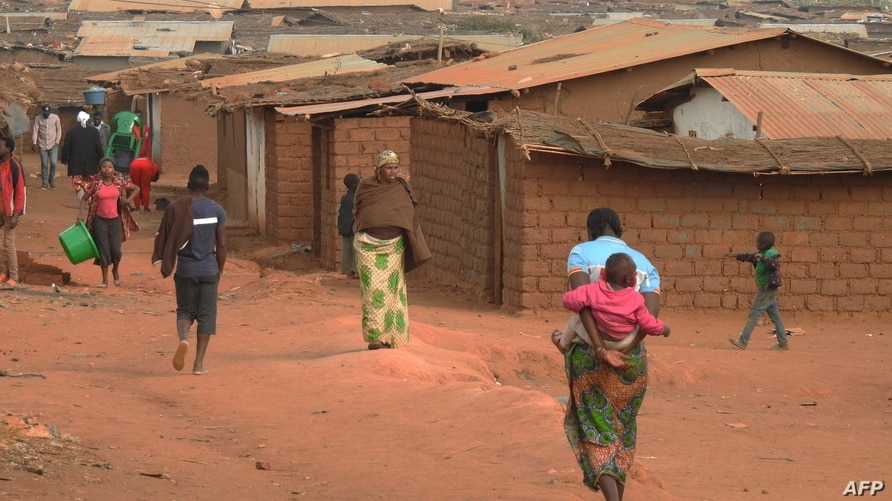 FILE - Refugees of various nationalities walk through Dzaleka refugee camp, Dowa district, in Malawi's Central region, June 20, 2018.