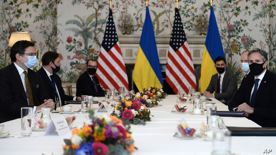 Ukrainian Foreign Minister Dmytro Kuleba, left, meets with United States Secretary of State Antony Blinken, right, in Brussels, Belgium, April 13, 2021.