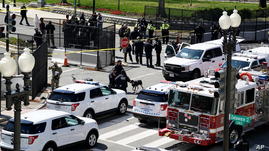 U.S. Capitol Police officers investigate near a car that crashed into a barricade on Capitol Hill near the Senate side of the U.S. Capitol in Washington, April 2, 2021.