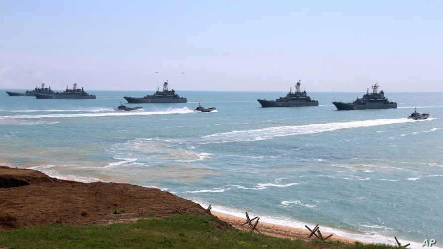 This handout photo released April 22, 2021, by Russia's Defense Ministry shows Russian navy ships preparing to unload troops during drills in Crimea, a peninsula Russia annexed from Ukraine in 2014.