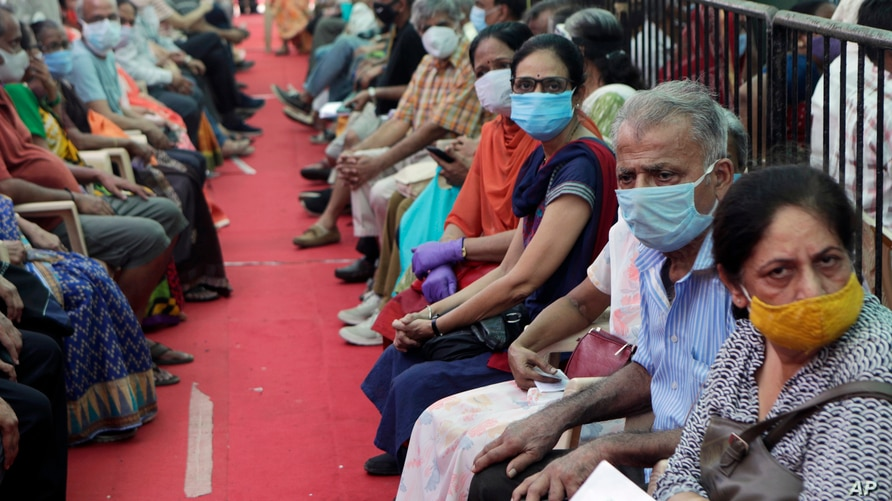 People wait to receive COVID-19 vaccine in Mumbai, India, April 29, 2021.