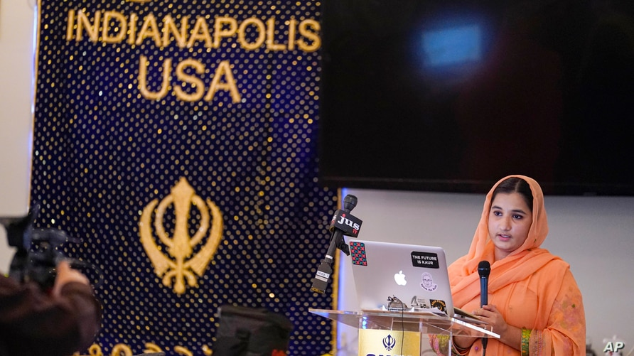 Aasees Kaur, legal client and community services manager of the Sikh Coalition reads a statement to the shooting at a FedEx facility at the Sikh Satsang of Indianapolis, April 17, 2021.
