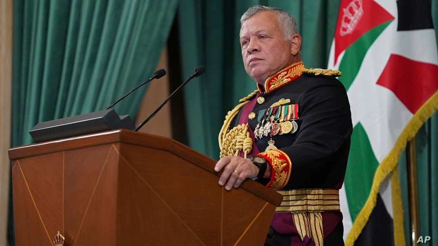 FILE - In this Dec. 10, 2020 file photo released by the Royal Hashemite Court, Jordan's King Abdullah II gives a speech during the inauguration of the 19th Parliament's non-ordinary session, in Amman.