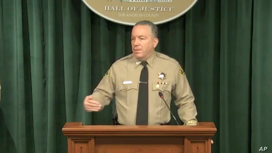 In this image take from a livestream video feed provided by the Los Angeles County Sheriff's Department, Sheriff Alex Villanueva speaks during a news conference, April 7, 2021, about the Tiger Woods' accident.