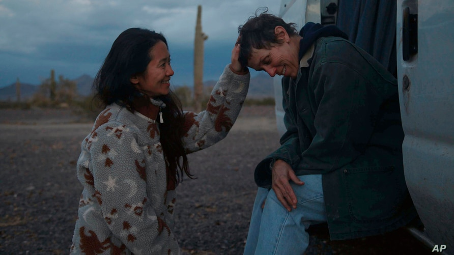 """FILE - In this photo, director Chloe Zhao, left, appears with actress Frances McDormand on the set of """"Nomadland."""""""