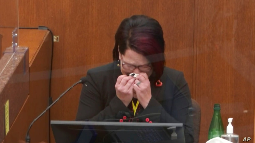 In this image from video, witness Courteney Ross tears up as she answers questions at the trial of former Minneapolis police officer Derek Chauvin at the Hennepin County Courthouse in Minneapolis, Minnesota, April 1, 2021.