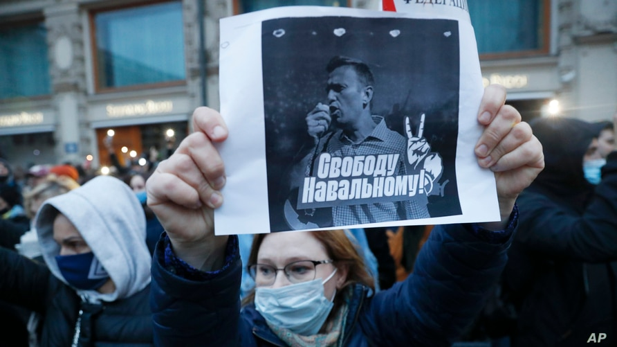 "A activist holds a poster reading ""Freedom for Navalny!"" during the opposition rally in support of jailed opposition leader Alexei Navalny in Moscow, Russia, April 21, 2021."