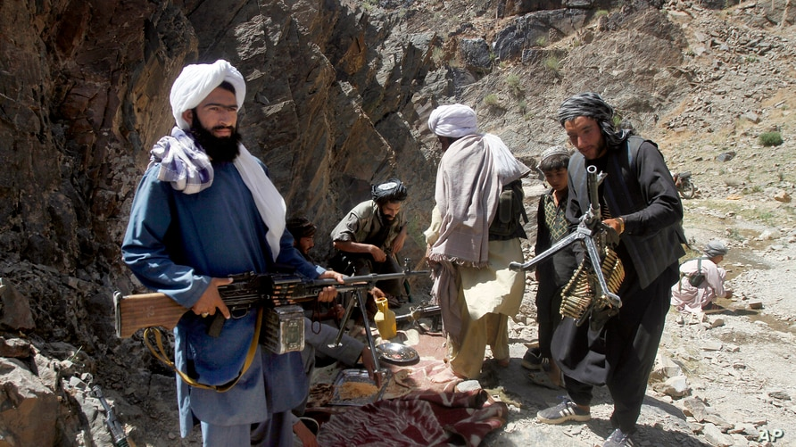 FILE - Armed Taliban fighters are seen in Herat province, Afghanistan, May 27, 2016.