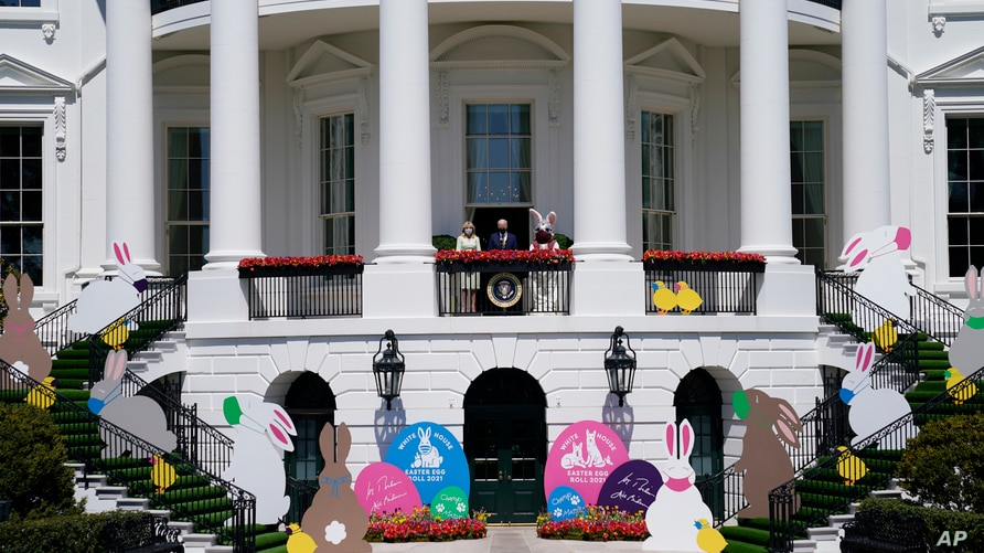 President Joe Biden appears with first lady Jill Biden and the Easter Bunny on the Blue Room balcony at the White House, April 5, 2021, in Washington.
