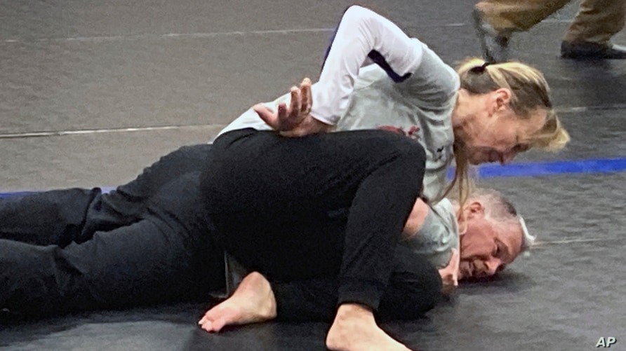 Eve Steffans of the Martial Arts Academy in Billings, Montana, practices judo techniques on Ed Thompson, a retired police officer, during a training session, March 9, 2021, in Douglas, Wyoming.