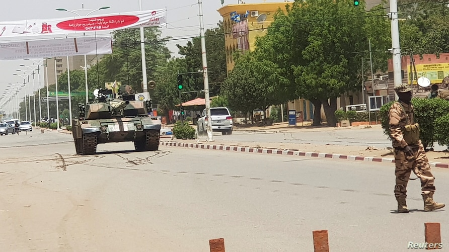 FILE - A Chad army tank is seen on a street as fighters from the rebel Front for Change and Concord in Chad (FACT) appeared to be moving toward the capital, according to the United States, in N'djamena, Chad, April 19, 2021.