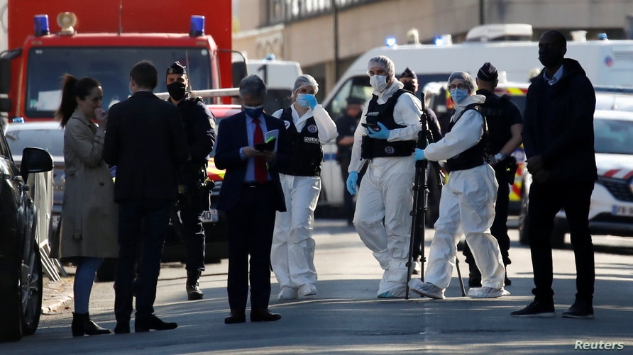 Police officers secure the area where an attacker stabbed a female police administrative worker, in Rambouillet, near Paris, France, April 23, 2021.