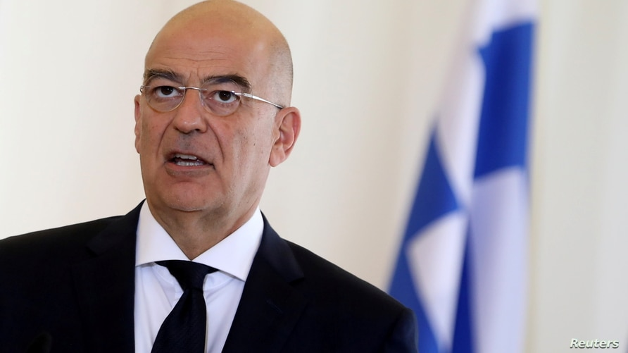 FILE - Greek Foreign Minister Nikos Dendias speaks during a news conference at the Foreign Ministry in Athens, Greece, Oct. 26, 2020.