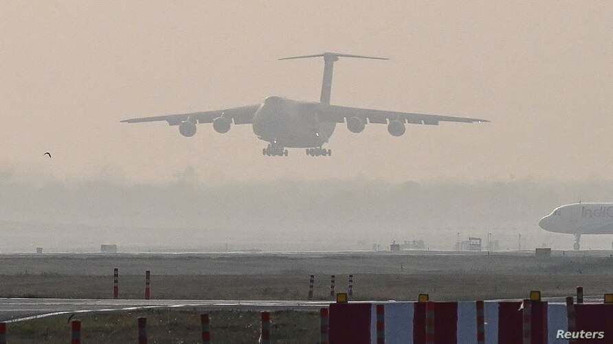 A U.S. Air Force aircraft carrying COVID-19 relief supplies from the U.S. prepares to land at the Indira Gandhi International Airport's cargo terminal in New Delhi, India, April 30, 2021.