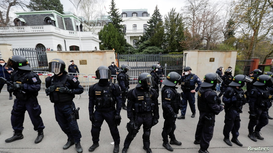 Police officers stand outside the Russian Embassy during a protest over Russian intelligence services alleged involvement in an ammunition depot explosion in the Vrbetice area in 2014, in Prague, Czech Republic, April 18, 2021.