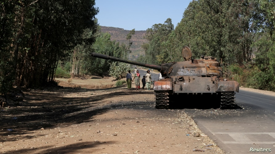 FILE - A burnt out tank stands near the town of Adwa, in Ethiopia's Tigray region, March 18, 2021.
