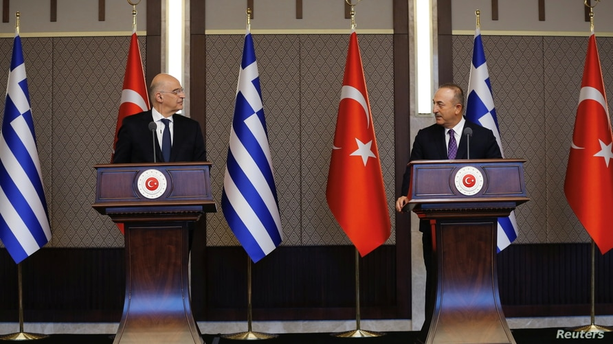 Turkish Foreign Minister Mevlut Cavusoglu and his Greek counterpart Nikos Dendias hold a news conference in Ankara, Turkey, April 15, 2021. (Turkish Foreign Ministry/Handout via Reuters)