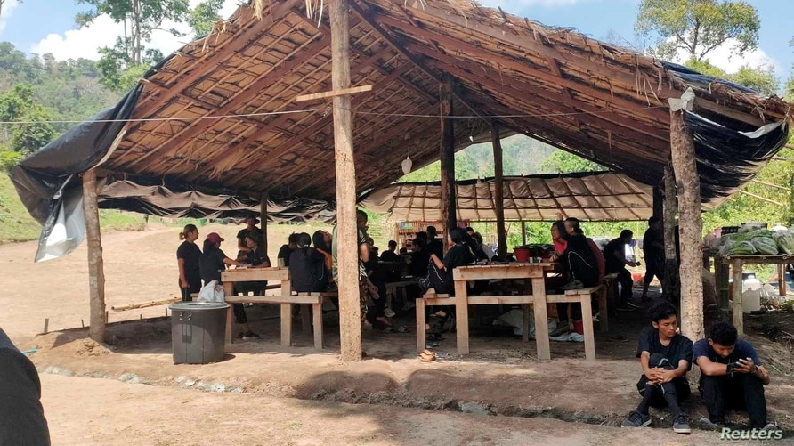 Recruits for a new force formed by protesters receive classroom instruction  at a training camp in an area held by an ethnic armed group in Karen State, Myanmar, April 9, 2021 in this picture obtained on April 26.