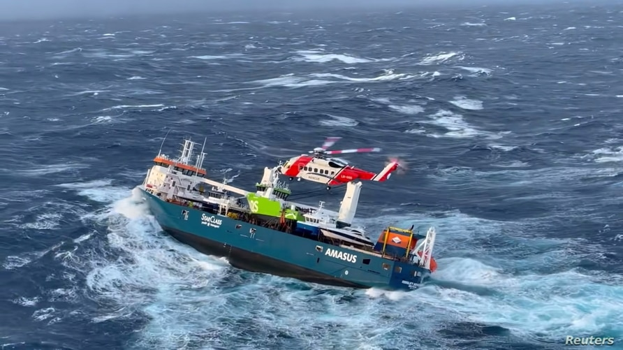 Crew members onboard Dutch cargo ship Eemslift Hendrika is evacuated in stormy weather off the coast of Norway in the North Sea, April 5, 2021.