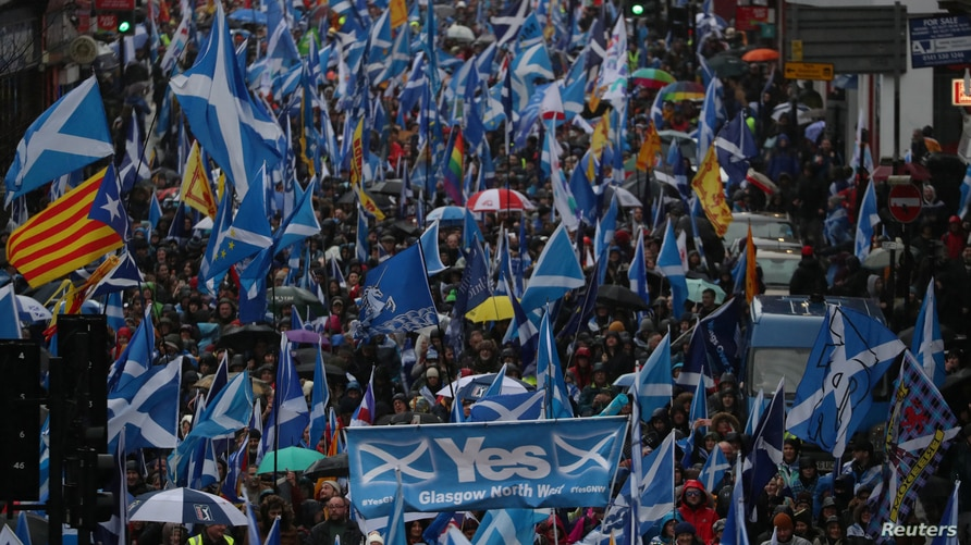 FILE - Demonstrators march for Scottish Independence through Glasgow City center, Scotland, Britain, Jan.11, 2020.