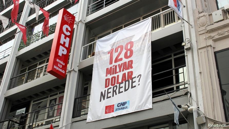 """A banner reading """"Where is the $128 billion?"""" hangs at the Beyoglu district office of main the opposition Republican People's Party (CHP) in Istanbul, Turkey, April 13, 2021."""