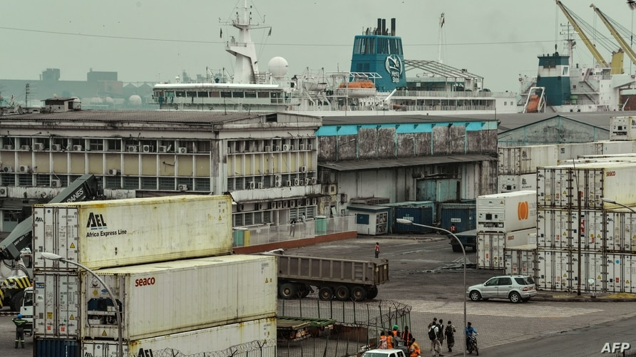 A picture taken on March 15, 2018 shows a general view of the port of Douala. (Photo by Reinnier KAZE / AFP)