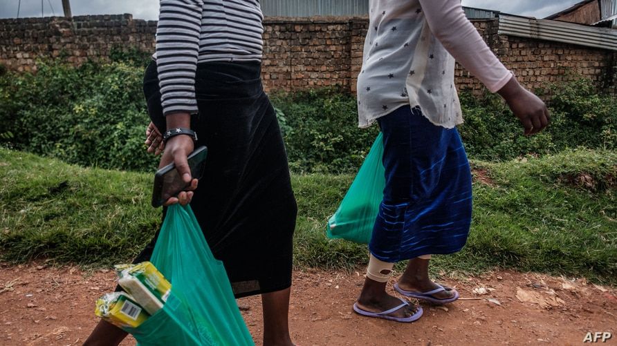 Sex workers walk back to home after receving distributions from staff members of Lady Mermaid's Bureau (LMB) during the…