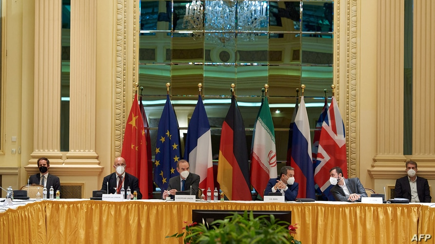 This handout photo taken and released on May 1, 2021 by the EU Delegation in Vienna shows delegation members from the parties…