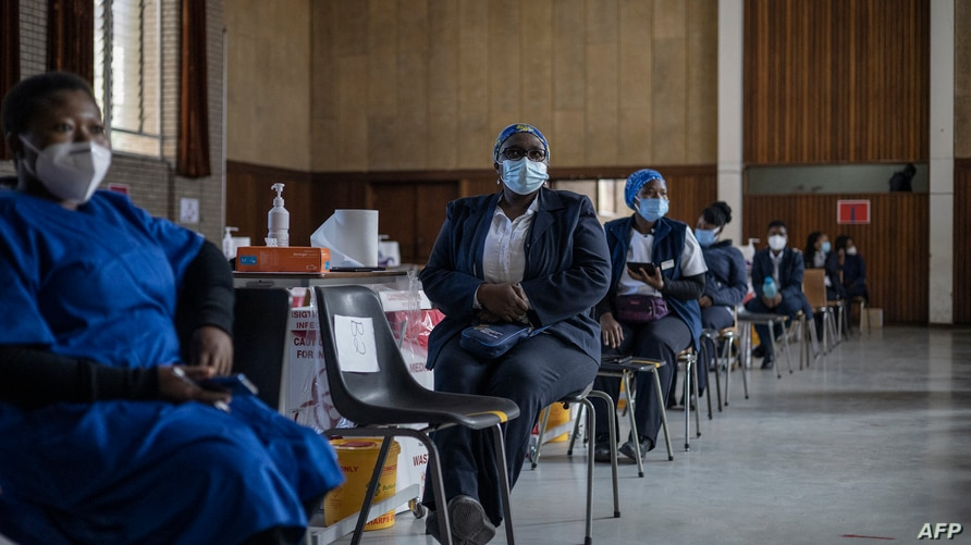 Health care workers awaits doses to start vaccinating people with Pfizer vaccines at the Bertha Gxowa Hospital in Germiston, on…