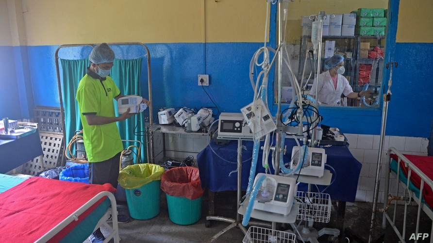 A medical staff checks the equipments inside a hospital ward which will be used in treating Covid-19 coronavirus patients at…