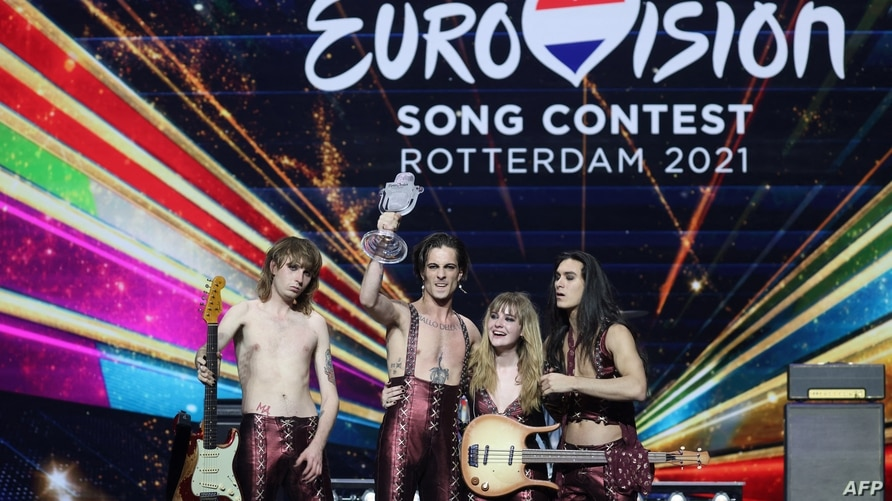 Italy's Maneskin pose for pictures on stage with the trophy after winning the final of the 65th edition of the Eurovision Song…