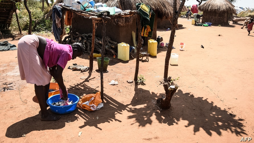 A South Sudanese refugee washes clothes  at the Bidibidi refugee settlement in the Northern District of Yumbe, Uganda, on…