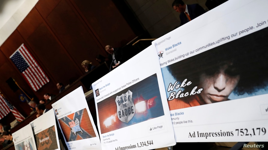 Examples of Facebook pages are seen, as executives appear before the House Intelligence Committee to answer questions related…