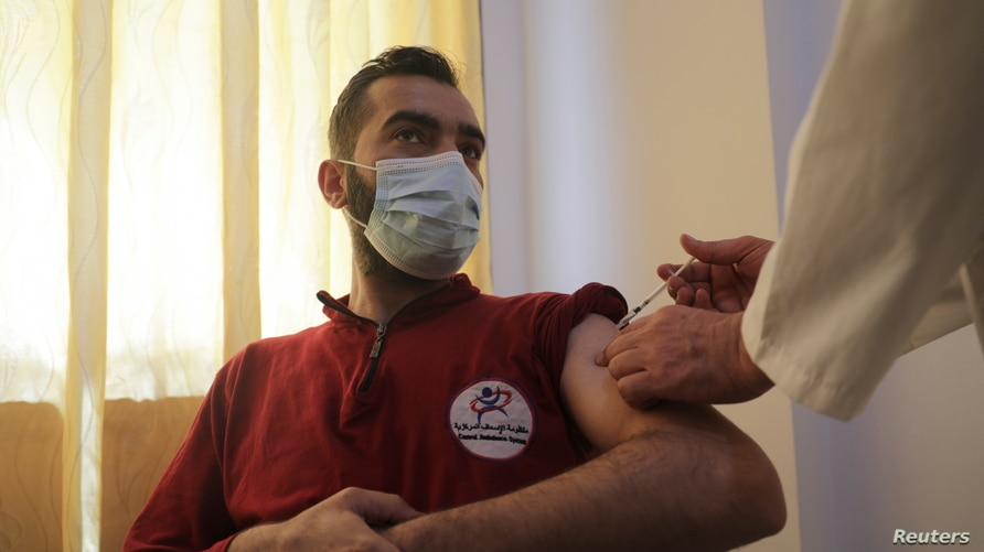 A man receives a dose of the coronavirus disease (COVID-19) vaccine at a hospital in Idlib, Syria, May 1, 2021. REUTERS/Khalil…