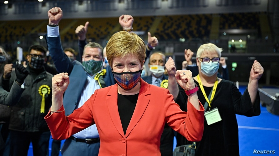 Scottish First Minister Nicola Sturgeon reacts after being declared the winner of the Glasgow Southside seat  at Glasgow…