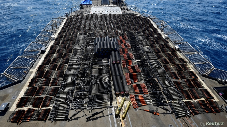 Thousands of illicit weapons are displayed onboard the guided-missile cruiser USS Monterey (CG 61) which was seized from a…