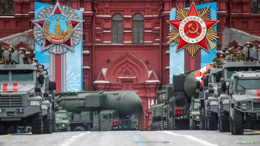 Russian military vehicles including Yars intercontinental ballistic missile systems drive along Red Square during a parade on…