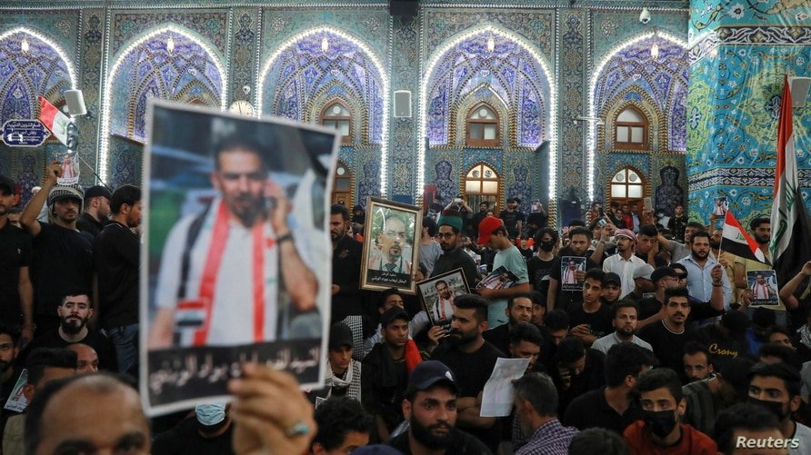 Mourners attend a funeral of Iraqi civil society activist Ehab al-Wazni, who was killed by unidentified gunmen, in Kerbala,…