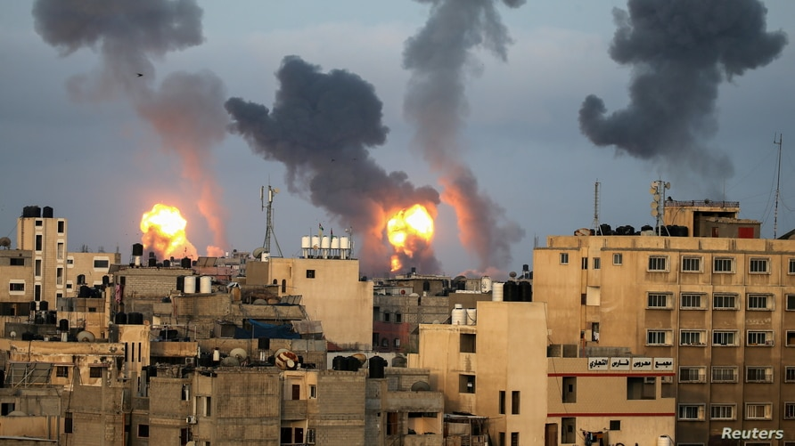 Flames and smoke rise during Israeli air strikes amid a flare-up of Israel-Palestinian violence, in the southern Gaza Strip.