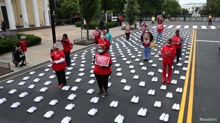 """National Nurses United (NNU) holds a protest against working conditions and a gathering to """"to honor the more than 400…"""